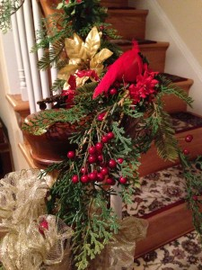 A faux garland with cardinals on my stair railing (Photo Credit: Adroit Ideals)