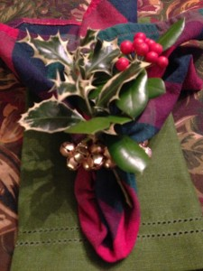 Add a sprig of holly for a festive napkin (Photo Credit: Adroit Ideals)