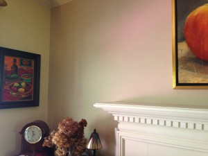 Exterior Pink Hue from Azaleas on Interior Cafe Latte colored wall (Photo Credit: Adroit Ideals)