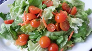 Bibb lettuce salad with cherry tomatoes from the garden  (Photo Credit: Adroit Ideals)