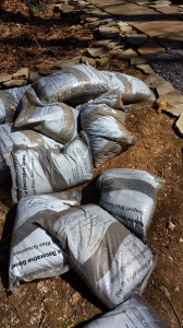 Fifteen bags of bluestone subbase and five bags of bluestone dust for my slate walk project.