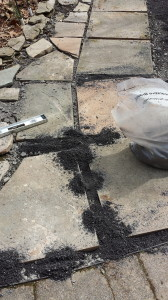 Bluestone dust waiting to be swept between the slate pieces.