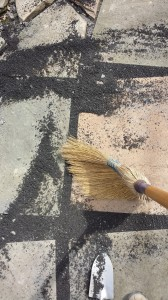 Sweep the bluestone dust between the slate pieces with a broom.  Yes, that's my shoe!